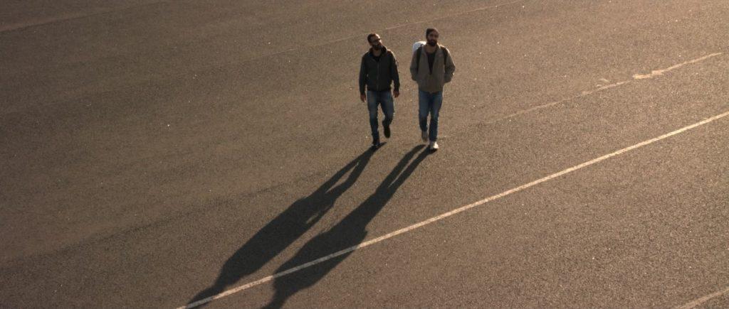 Katharsis Filmstill Flugplatz Juan Hasan und Samir Fuchs